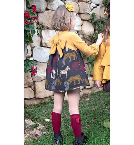 Vestido niña cuerpo punto mostaza y falda animales de Nekenia | Aiana Larocca