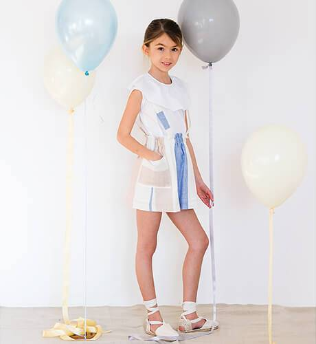 Falda niña a rayas con tirantes de Ancar | Aiana Larocca