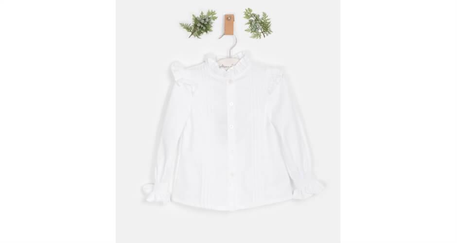 Blusa blanca volantito hombro de José Varón   Aiana Larocca